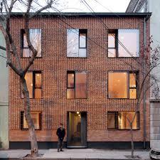 modern brick house mapa updates chilean housing block with textured brick facade