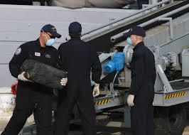 file us navy 080714 n 5677b 008 u s customs agents offload bales