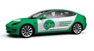 food delivery service turns to tesla model 3 in bid to replace
