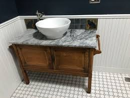 marble and grey hexagon tile complete bathroom u0027s historic feel