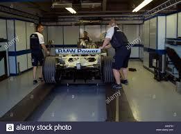 formula 1 racing car pit lane garage weighing station bmw gilles formula 1 racing car pit lane garage weighing station bmw gilles villeneuve grand prix race track montreal canada june 2004