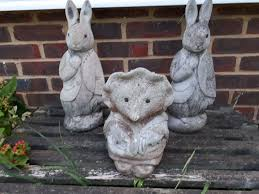 pair of effect rabbit garden figures and a mrs