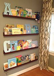 Floating Shelves In A Baby Nursery Take The Place Of A Free Standing