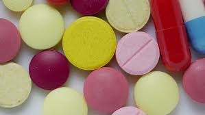 a lot of colored medical pills tablets and capsules rotation on
