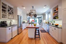 galley kitchen with island butcher block breakfast bar kitchen craftsman with wood floors
