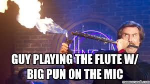 Flute Player Meme - playing the flute w big pun on the mic