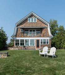 gambrel style house exterior victorian with shingle siding window