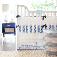 baby boy bedding set on white wooden crib plus antique laudry
