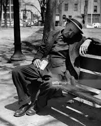 drunk senior man sitting on a park bench stock photo getty images