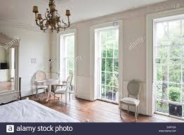 white bedroom with full length windows in the reading rooms