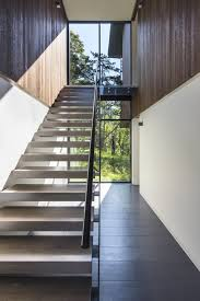 photo 6 of 10 in an incredible forest home leaps over a ravine dwell