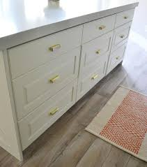 kitchen island drawers white kitchen island drawers with brass pulls transitional kitchen