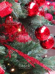 artificial christmas tree red decorations garlands baubles tinsel