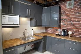 kitchen countertop tile exposed brick chimney in kitchen round black webbing pendant lamp
