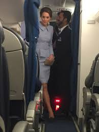 kate joins stunned commoners on commercial flight home from