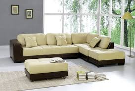 black leather sofa with cream cushion with bench on soft grey