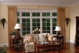 bay window living room plain light blue wallpaint white classic