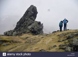 two fellwalkers by the howitzer or lion and the lamb rock