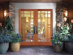 glass and wooden doors brown wooden door with glass on the top with bars placed on the