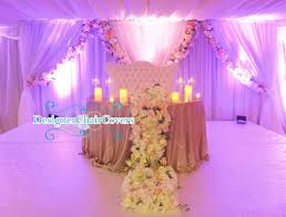 wedding backdrop london the sweetheart table with cascading flowers designer chair