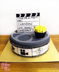 hollywood themed party film reel cake with cupcakes happy cake