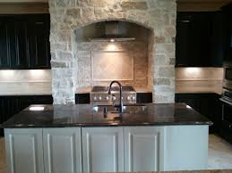 kinsmen homes custom built home kitchen with stone arch over range