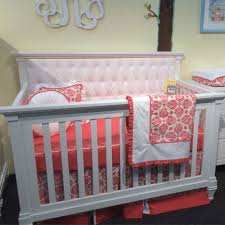 belmont convertible crib french white with white tufted panel and