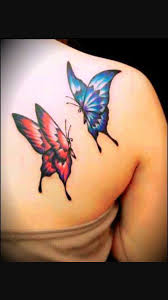 and blue two flying butterflies on back shoulder