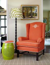 Orange Living Room Chairs by Decorating With Orange An Instant Pick Me Up Traditional Home
