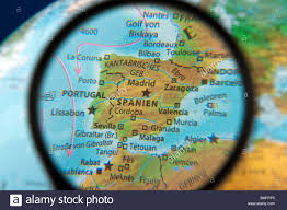 Spain On World Map by Spain On A Globe Through The Magnifying Glass Stock Photo Royalty