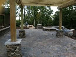 backyard brick paver patio with pergola fire pit and retaining