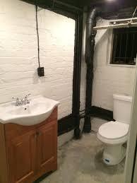 half bath between awnings and astroturf