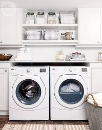 Countertop Clothes Dryer Washer And Dryer Tucked Under Marble Countertop Transitional