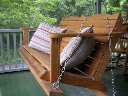 Hanging Patio Chair country house porch with wooden hanging chair feat classic pillows