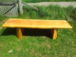 handcrafted log home log cabin firewood shed picnic table bench