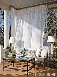 Sheer Curtain Panels Attached To Rings Hang On Aluminum Rods