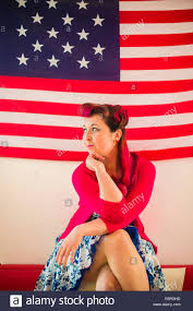 Flag Clothing A Woman Wearing 50 U0027s Style Retro Clothing Sitting In Front Of A