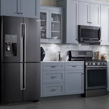 white kitchen cabinets and black stainless steel appliances samsung black stainless steel appliances