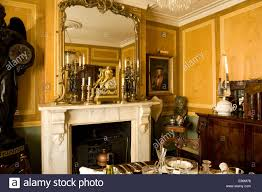 mirrors in dining room ornate mirror above fireplace in traditional country house dining