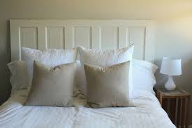 bedroom rustic brown wood headboard and white bedlinen pillows