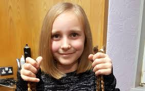8 chops off her hair to raise hundreds of pounds for cancer