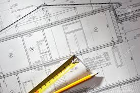 House Plan Blueprints Pencil And Tape Meausure Over House Plan Blueprints Stock Photo