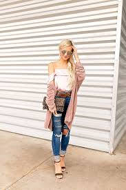 blush silk top and ripped high waisted skinny jeans