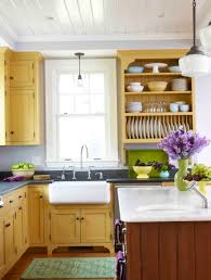 yellow kitchen cabinets white walls home design ideas