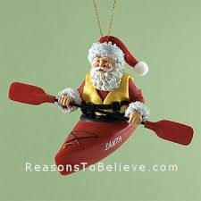 chuting the rapids orn santa claus figurines and carved