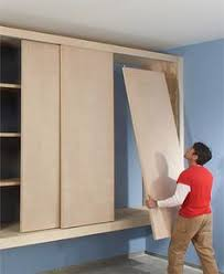 Build Wood Garage Cabinets by How To Build Storage Above Garage Door Organizationnn