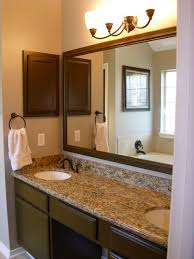 gray wall paint granite countertop mirror with dark wooden frame