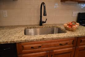 tiles backsplash honey onyx mosaic tile laundry room cabinet