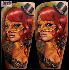 bow masquerades masked tattoo on thigh