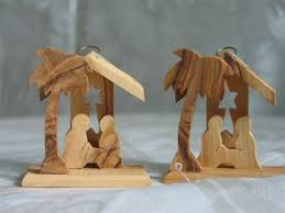 olive wood nativity ornament with glowing candles